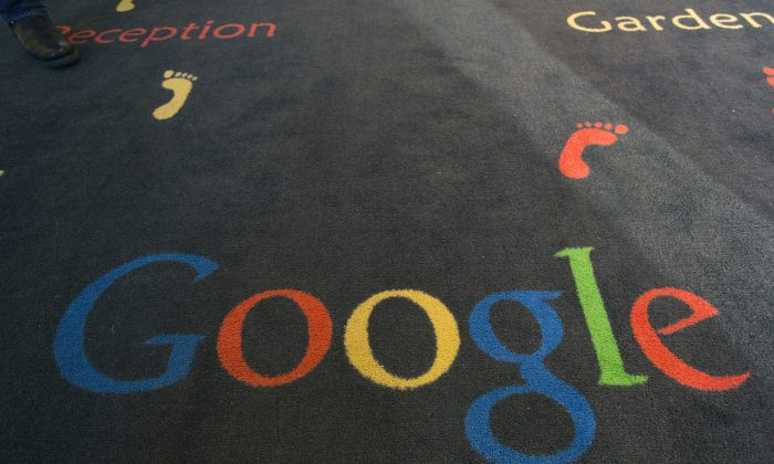 """FILE -  This Tuesday, Dec. 10, 2013 file photo shows the Google logo printed on a carpet during the inauguration of the new Google cultural institute in Paris, France. French police have raided Google's Paris offices as part of an investigation into """"aggravated tax fraud"""" and money laundering, authorities said Tuesday. (AP Photo/Jacques Brinon, File)"""