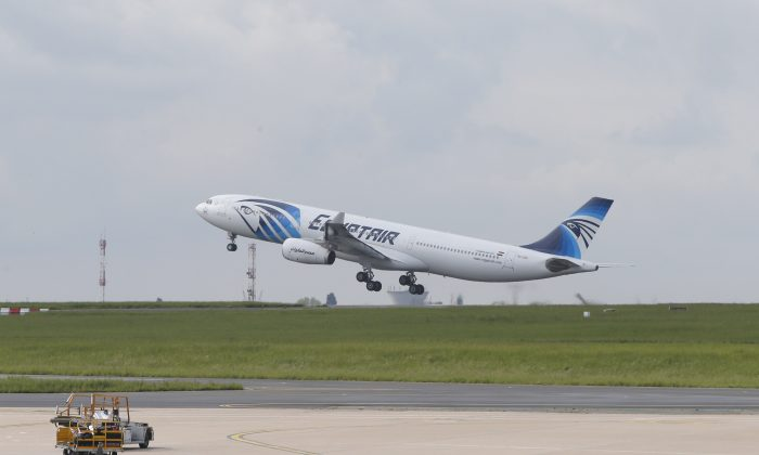 An EgyptAir Airbus A330-300 takes off for Cairo from Charles de Gaulle Airport outside of Paris, Thursday, May 19, 2016. (AP Photo/Christophe Ena)