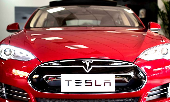 This picture taken on March 17, 2015 shows a Tesla Model S car on display at a showroom in Shanghai. (Johannes Eisele/AFP/Getty Images)