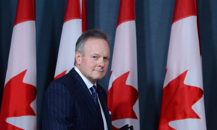 BankofCanadagovernor Stephen Poloz arrives at a news conference at the National Press Theatre in Ottawa on April 13, 2016. Canada's central bank kept its key rate unchanged on May 25. (The Canadian Press/Sean Kilpatrick)