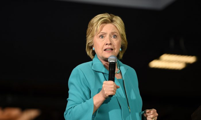 Democratic presidential hopeful Hillary Clinton speaks at the IBEW Local 11 union hall during a campaign event in Commerce, California, May 24, 2016.   (Photo credit should read ROBYN BECK/AFP/Getty Images)