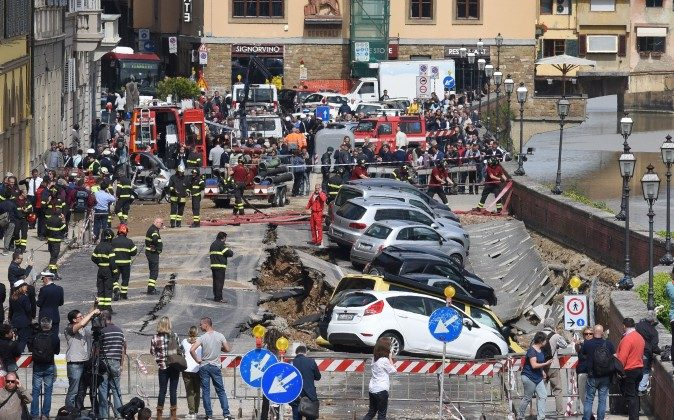 Firemen work along the Arno river where the embankment running alongside the Arno river collapsed early on May 25, 2016 in central Florence. The damage, stretching between the 14th century Ponte Vecchio and the Ponte alle Grazie, affected about 200 metres of the embankment in total. Emergency services said the collapse was due to a water pipe break and authorities stopped traffic along the road.   / AFP / CLAUDIO GIOVANNINI        (Photo credit should read CLAUDIO GIOVANNINI/AFP/Getty Images)