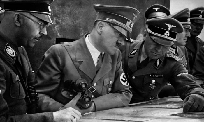 A picture dated 1939 shows German Nazi Chancellor and dictator Adolf Hitler (C) consulting a geographical survey map with his general staff. (AFP/Getty Images)