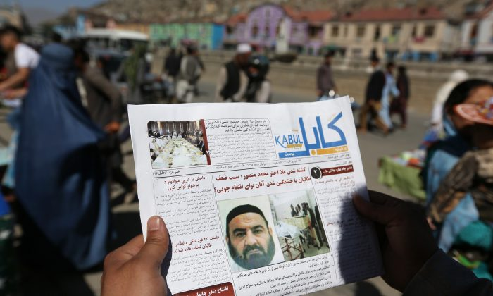 An Afghan man reads a local newspaper with photos the former leader of the Afghan Taliban, Mullah Akhtar Mansoor, who was killed in a U.S. drone strike last week, in Kabul, Afghanistan, Wednesday, May 25, 2016. The Afghan Taliban has confirmed that its former leader Mullah Akhtar Mansour was killed in a U.S. drone strike last week and appointed a successor. In a statement sent to media Wednesday, May 25, 2016, the insurgent group said its new leader is Mullah Haibatullah Akhundzada, one of two Mansour's deputies. (AP Photo/Rahmat Gul)