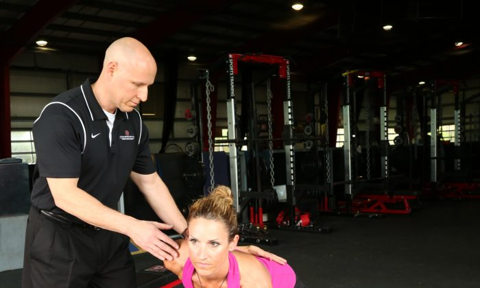 Physical therapist Chris Kolba works on glute exercises with patient Jennifer Ernst. (Ohio State University Wexner Medical Center)