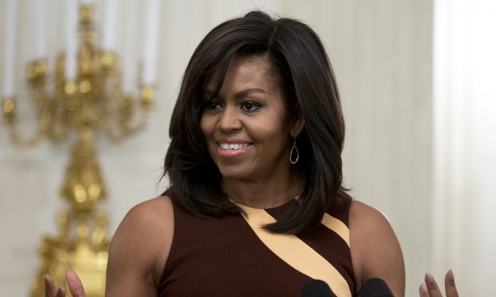 First lady Michelle Obama speaks to high school students from across the Washington D.C. area in the State Dining Room of the White House in Washington. (AP Photo/Carolyn Kaster)