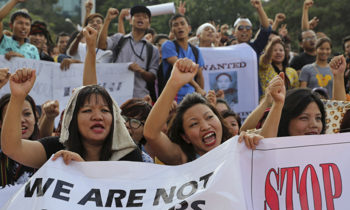 Members of Manipur Tribal Union shout slogans during a protest against new legislation defining who can claim to be from the northeastern Indian state of Manipur, in Bangalore, India, on Sept. 4, 2015. (AP Photo/Aijaz Rahi)