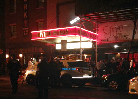Authorities stand outside Irving Plaza, near Manhattan's Union Square in New York after a shooting Wednesday, May 25, 2016. Police say several were injured in a deadly shooting inside the concert venue, where hip-hop artist T.I. was scheduled to perform. (AP Photo/Dana Schimmel)