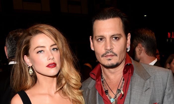 """Actors Amber Heard (L) and Johnny Depp attend the """"Black Mass"""" premiere during the 2015 Toronto International Film Festival at The Elgin on Sept. 14, 2015 in Toronto. (Jason Merritt/Getty Images)"""