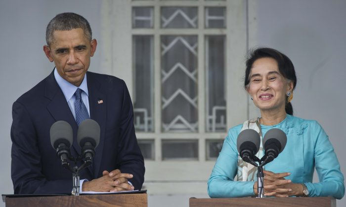 President Barack Obama (L) and then opposition leader, now Burma State Counselor and Foreign Minister Aung San Suu Kyi (R) in a press conference at her residence in Yangon on Nov. 14, 2014. (Mandel Ngan/AFP/Getty Images)