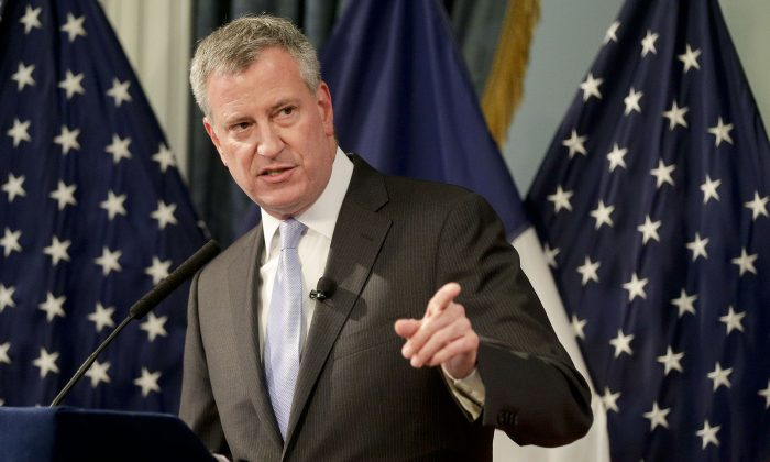 NYC Mayor Bill de Blasio during his executive budget presentation in New York City on May 7, 2015. During the presentation De Blasio also discussed additional funds for road repairs, reforms at Rikers Island, and public housing. (Julie Jacobson/Getty Images)
