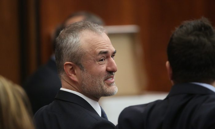 Nick Denton, founder of Gawker, talks with his legal team before Terry Bollea, aka Hulk Hogan, testifies in court during his trial against Gawker Media at the Pinellas County Courthouse on March 8, 2016 in St Petersburg, Florida. (Photo by John Pendygraft-Pool/Getty Images)