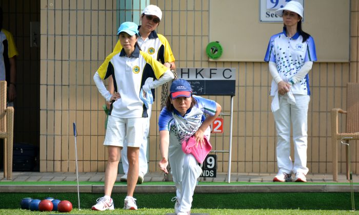Hong Kong international Dorothy Yu (delivering) helped her Hong Kong Football Club team to victory in a crucial Premier division 1 match against the Shatin Sports Association last weekend, May 21. HKFC won the game 8-0 to maintain their pole position after the match on Saturday May 21, 2016. (Stephanie Worth)