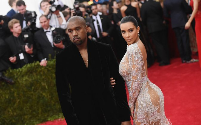Kanye West (L) and Kim Kardashian attend the 'China: Through The Looking Glass' Costume Institute Benefit Gala at the Metropolitan Museum of Art on May 4, 2015 in New York City. (Mike Coppola/Getty Images)