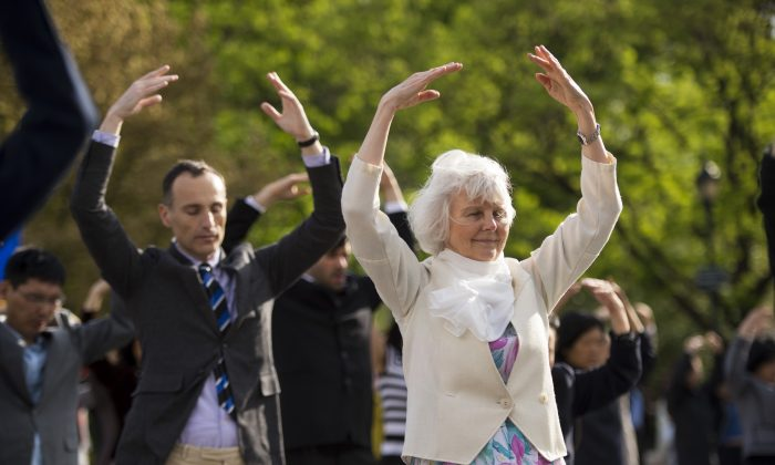 People practice the Falun Dafa exercises at Union Square in Manhattan on May 13, 2014. (Edward Dye/Epoch Times)