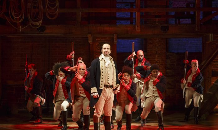"""In this image released by The Public Theater, Lin-Manuel Miranda, center, performs in the musical """"Hamilton"""" in New York. David Korins was nominated for a Tony Award for set design for his work on """"Hamilton."""" The Tony Awards will be held in New York on Sunday, June 12, 2016. (AP Photo/The Public Theater, Joan Marcus)"""