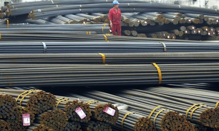 A Chinese works in a steel market in Yichang in central China's Hubei Province, on April 25, 2016. (Chinatopix via AP)