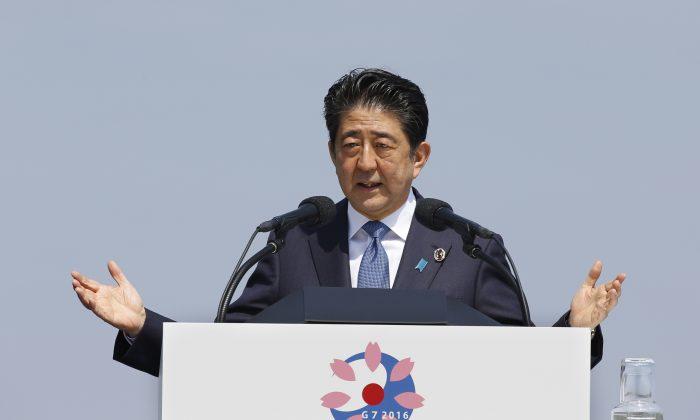 Japanese Prime Minister Shinzo Abe speaks at a press conference at the G-7 summit in Shima, central Japan, Friday, May 27, 2016. (AP Photo/Shizuo Kambayashi)