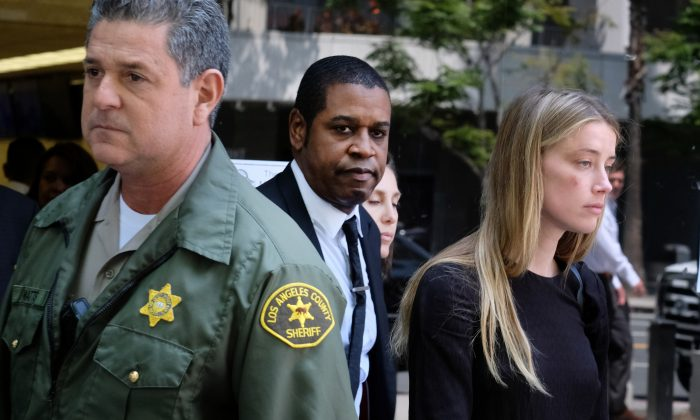 Actress Amber Heard leaves Los Angeles Superior Court court on Friday, May 27, 2016, after giving a sworn declaration that her husband Johnny Depp threw her cellphone at her during a fight. (AP Photo/Richard Vogel)