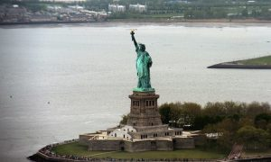 Woman Climbs Statue of Liberty on July 4