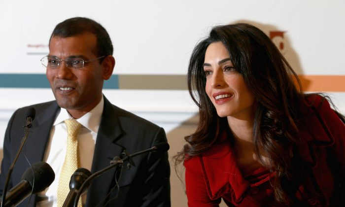 Mohamed Nasheed, former President of the Maldives, at a press  conference with his legal counsel Amal Clooney.  (Chris Jackson/Getty Images)