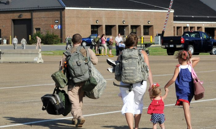 Staff Sgt. John Carlin walks off the flightline with his family May 13, 2001, at Little Rock Air Force Base, Ark. Sergeant Carlin is assigned to the 61st Airlift Squadron. (U.S. Air Force photo/Staff Sgt. Chris Willis)