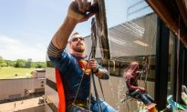 Window Washers Dress up as Superheroes to Clean Windows of Children's Hospital