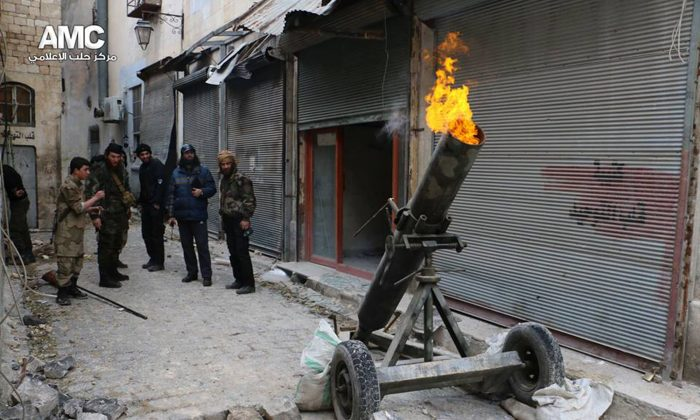 In this Sunday Feb. 15, 2015 photo shows Syrian rebels firing locally made shells against the Syrian government forces, in Aleppo, Syria. (AP Photo/Aleppo Media Center, AMC)