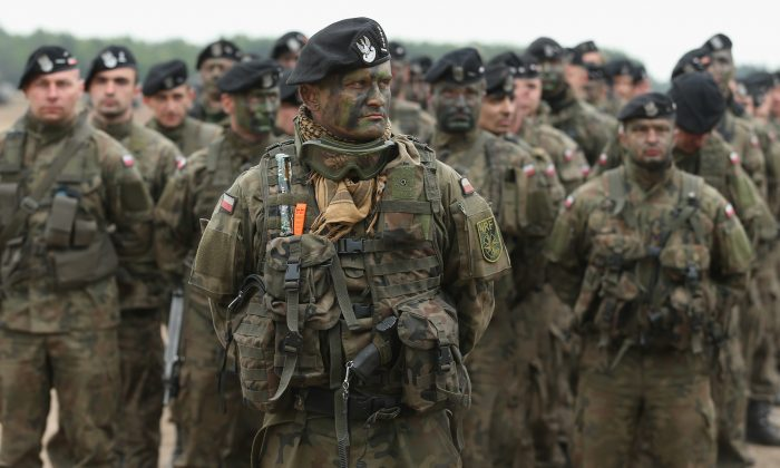 Polish soldiers participate in the NATO Noble Jump military exercises of the Very High Readiness Joint Task Force (VJTF) in Zagan, Poland on June 18, 2015. NATO has put a defense plan for Poland and Baltic states into action after Turkey dropped its objections officials said on July 1, 2020. (Sean Gallup/Getty Images)