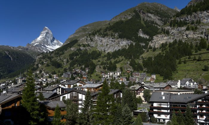 A Swiss village with Matterhorn mountain in the background. (FABRICE COFFRINI/AFP/Getty Images)