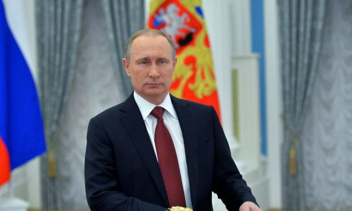 Russian President Vladimir Putin delivers a message dedicated to Russian women on International Women's Day in Moscow on March 8, 2016.  (ALEXEI DRUZHININ/AFP/Getty Images)