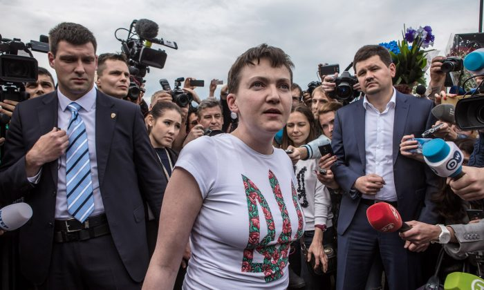 Ukrainian military pilot and Member of Parliament Nadiya Savchenko is surrounded by media upon her arrival at Kyiv Boryspil Airport, in Boryspil, Ukraine, on May 25, 2016. Savchenko was captured while fighting Russia-backed rebels in eastern Ukraine and put on trial in Russia on charges that she was complicit in the deaths of two Russian journalists. In March, she was convicted and sentenced to 22 years in prison, but was reportedly swapped for two Russian fighters captured by Ukrainian forces. (Brendan Hoffman/Getty Images)
