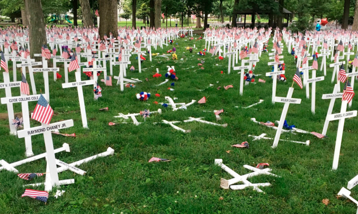 A Memorial Day display of crosses after a vehicle drove through them in Henderson, Ky.'s Central Park on Saturday, May 28, 2016. (Joe Whitledge/Henderson Police Department via AP)