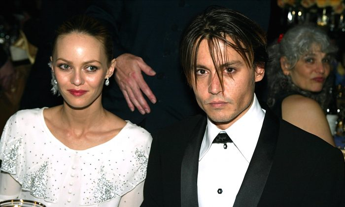 Actor Johnny Depp (R) and his wife Vanessa Paradis pose at the The Governors Ball after the 76th Annual Academy Awards at the Renaissance Hollywood Hotel on February 29, 2004 in Hollywood, California.  (Kevin Winter/Getty Images)