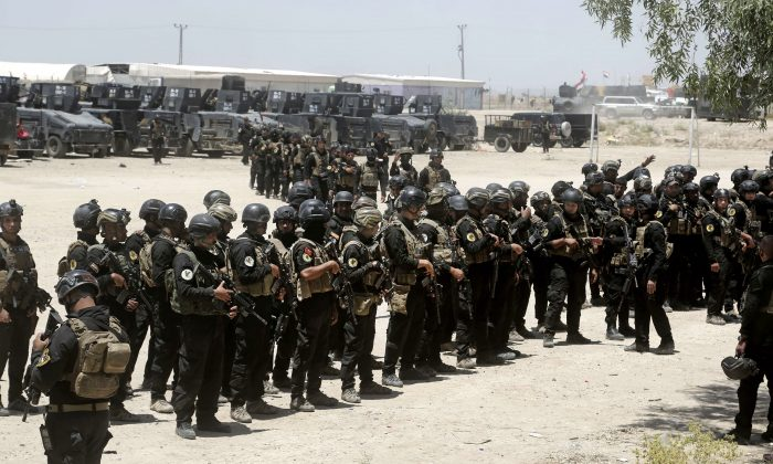 Iraq's elite counterterrorism forces gather ahead of an operation to retake ISIS-held city of Fallujah, Iraq, on May 29, 2016. (AP Photo/Khalid Mohammed)