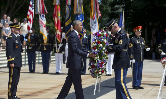 President Barack Obama lays a wreath at the Tomb of the Unknowns, on Memorial Day, Monday, May 30, 2016, at Arlington National Cemetery in Arlington, Va. (AP Photo/Pablo Martinez Monsivais)
