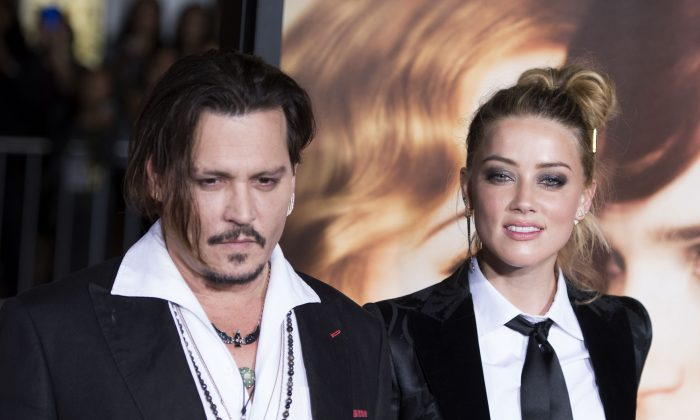 """Actors Johnny Depp (L) and Amber Heard attend the Los Angeles Premiere of """"The Danish Girl"""",  in Westwood, California, on November 21, 2015.(VALERIE MACON/AFP/Getty Images)"""
