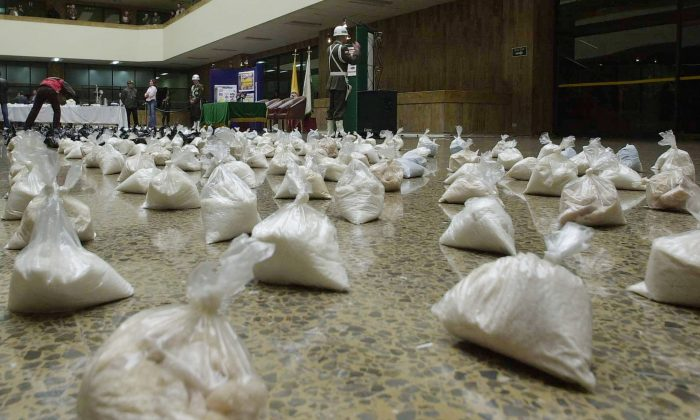 Police show off more than 120,000 tablets of Ecstasy that were confiscated, in Colombia, Bogota. (AP Photo/ Javier Galeano)