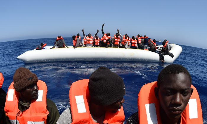 Migrants and refugees are rescued during an operation at sea on May 24, 2016, in the Mediterranean sea in front of the Libyan coast. (Gabriel Bouys/AFP/Getty Images)