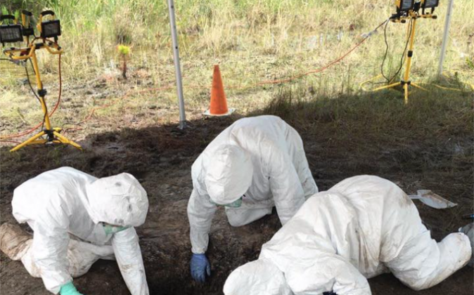 Todd's remains were containerized in a fluid substance suspected to be some form of acid. Hazmat crews seen here worked tirelessly for 48-hours to recover her body. (Martin County Sheriff's Office photo)