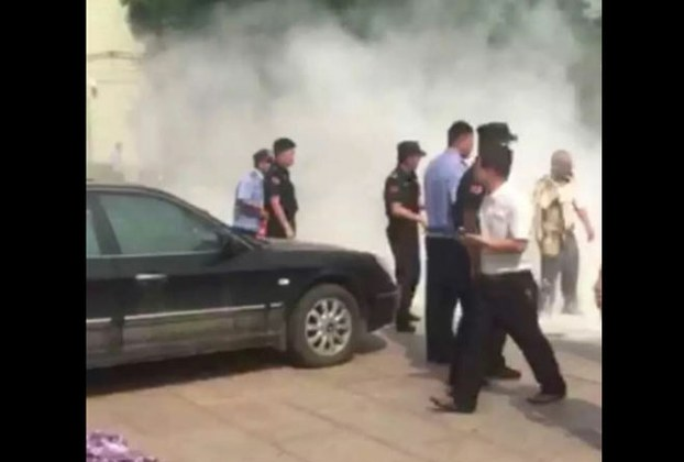 The scene of Liu's self-immolation as seen in a screenshot of footage taken by a bystander. (via RFA)