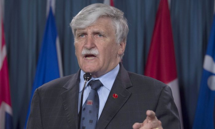 Former senator Romeo Dallaire speaks about torture in Syria during a news conference on Parliament Hill on May 31, 2016. (The Canadian Press/Adrian Wyld)