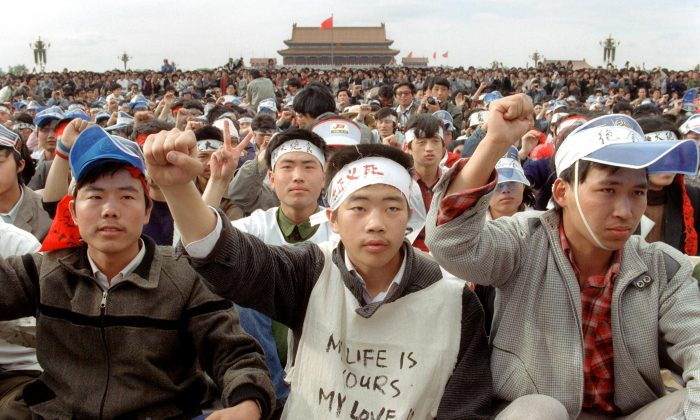 Students from Beijing University gather with thousands of other during a huge demonstration at Tiananmen Square as they start a hunger strike as the part of mass pro-democracy protest against the Chinese regime on May 18, 1989. (Catherine Henriette/AFP/Getty Images)