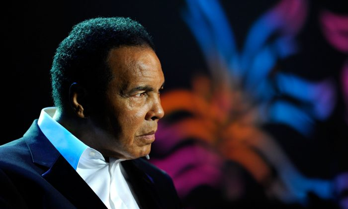 """Muhammad Ali onstage during the Michael J. Fox Foundation's 2010 Benefit """"A Funny Thing Happened on the Way to Cure Parkinson's"""" at The Waldorf=Astoria on November 13, 2010 in New York City.  (Photo by Andrew H. Walker/Getty Images for the Michael J. Fox Foundation for Parkinson's Research)"""