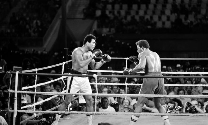 Former world heavyweight champion Muhammad Ali (L) and U.S. titleholder George Foreman (R) fight in Kinshasa, Zaire, on Oct. 30, 1974, during their world heavyweight championship match. Ali won by knocking out Foreman in the eighth round. (AFP/Getty Images)