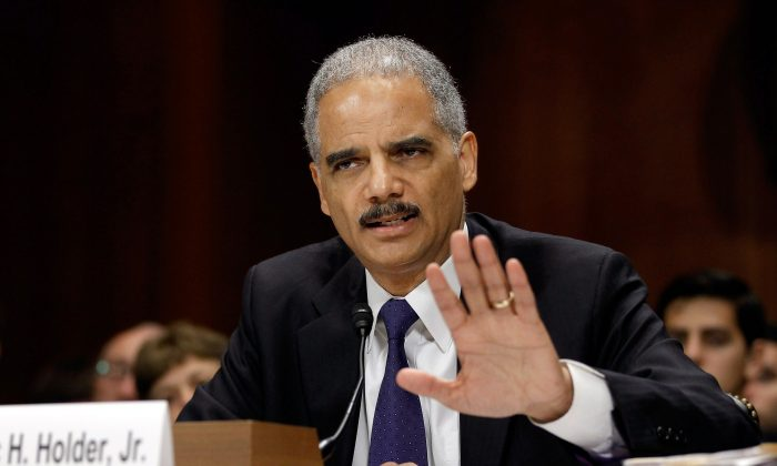 Former attorney general Eric Holder answers questions while testifying before the Senate Judiciary Committee on Capitol Hill in Washington on June 12, 2012. (Chip Somodevilla/Getty Images)