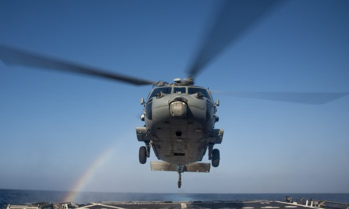 An MH-60R Sea Hawk helicopter of the Helicopter Maritime Squadron (HSM 37) lands on the flight deck of the guided-missile destroyer USS Chung-Hoon (DDG 93) on Feb. 23, 2016. Providing a ready force supporting security and stability in the Indo-Asia-Pacific, Chung-Hoon is operating as part of the John C. Stennis Strike Group and Great Green Fleet on a regularly scheduled 7th Fleet deployment. (U.S. Navy/Mass Communication Specialist 2nd Class Marcus L. Stanley)
