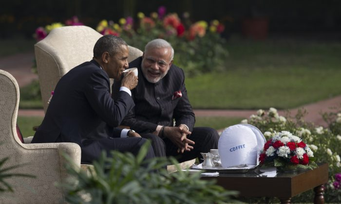President Barack Obama (L) and Indian Prime Minister Narendra Modi in the gardens of the Hyderabad House in New Delhi, India, on Jan. 25, 2015. (AP Photo/Carolyn Kaster)