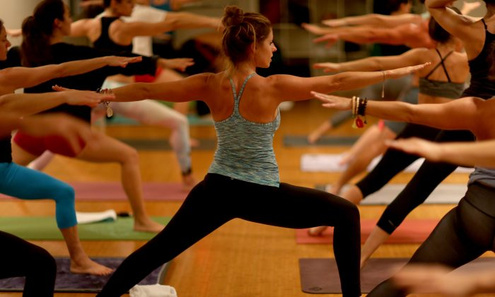 Amy Steiner (C) leads a yoga class while dressed in Lululemon Athletica yoga clothes at a yoga studio on Dec. 10, 2013, in Miami Beach, Fla. (Joe Raedle/Getty Images)