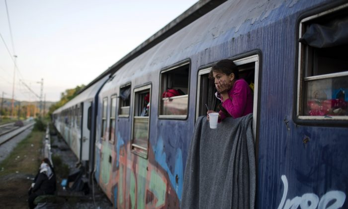 A Syrian girl looks out train window that she lives with her family in the sprawling refugee and migrant tent city of Idomeni, on Greece's northern border with Macedonia, on May 7, 2016. The evacuation of Idomeni has dashed the dreams of thousands migrants and refugees who had been camping there for months in the hopes of eventually being able to cross over the border and continue toward Europe's more prosperous heartland.(AP Photo/Petros Giannakouris)